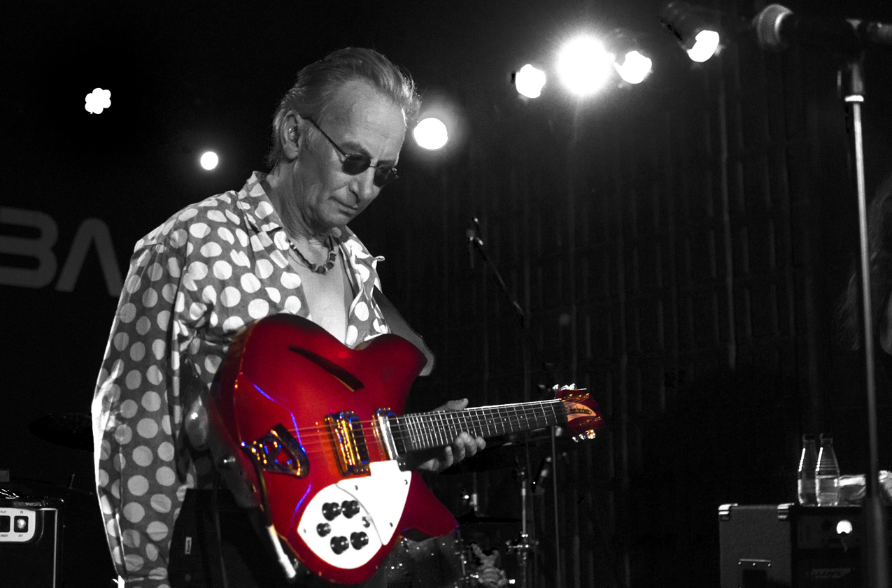 Kevin Ray Weatherill with a red Rickenbacker guitar