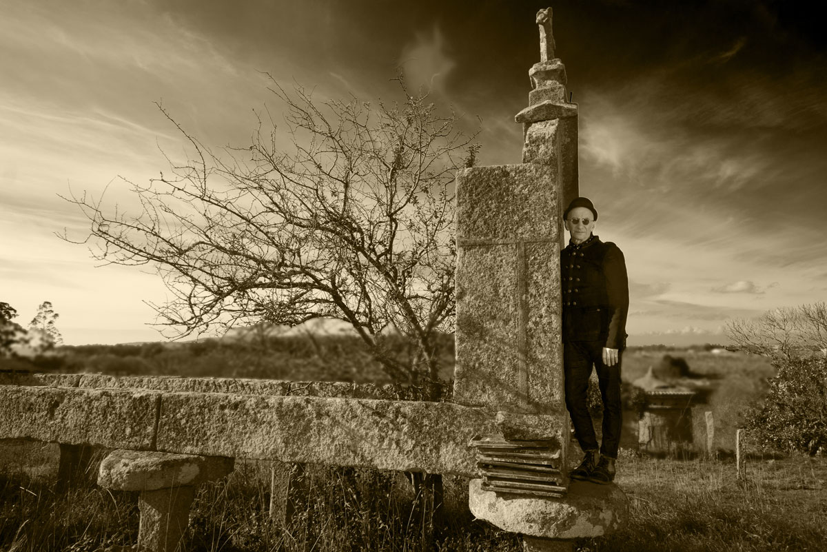 Kevin Raymond Weatherill standing on ruin in Galicia
