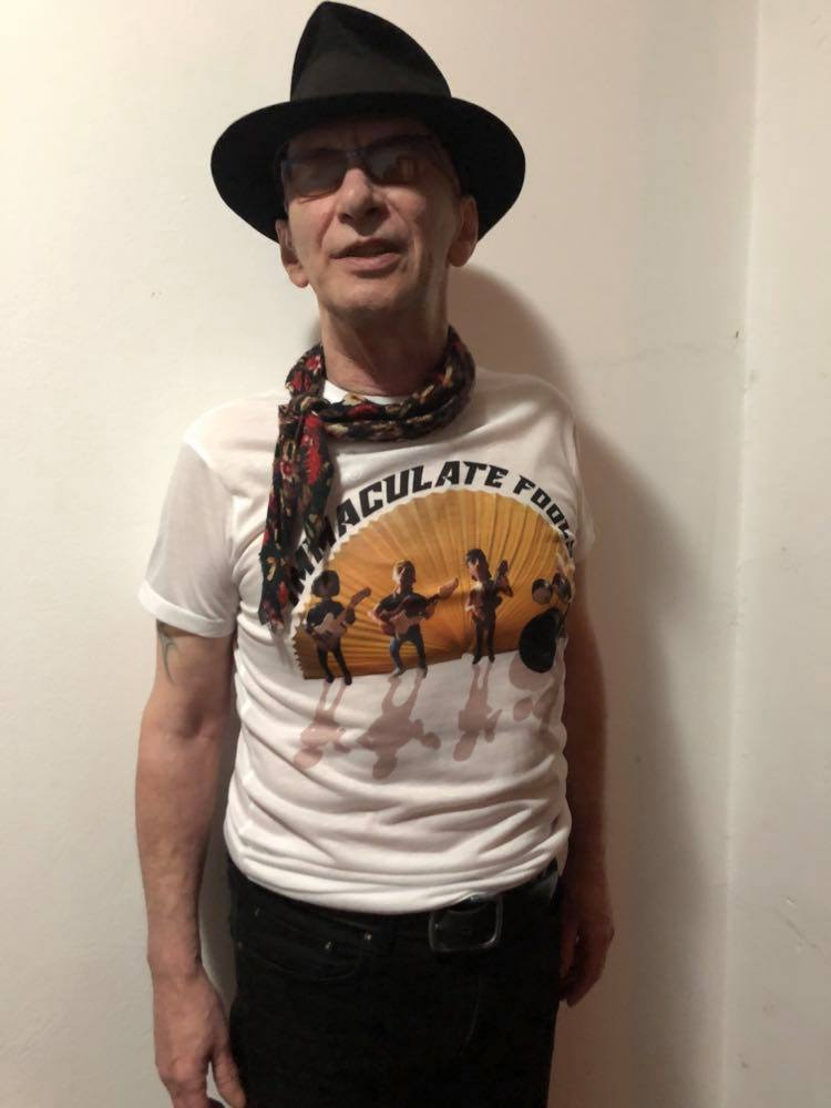 Kevin wearing Immaculate Fools doll T-shirt